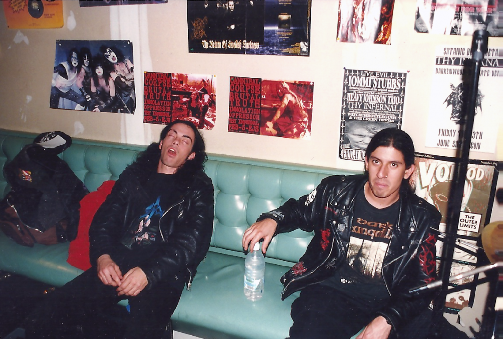 The rhythm section of Impaled, Ross Sewage and Raul Varela, on the road in 2000.