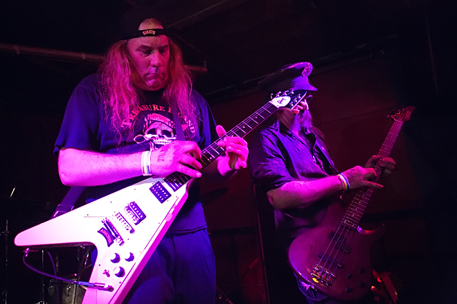 "Bob Wright and Jim Schumacher tapping the main riff to ""Cry of the Banshee"" at Thee Parkside in 2013. Photo courtesy of Raymond Ahner."