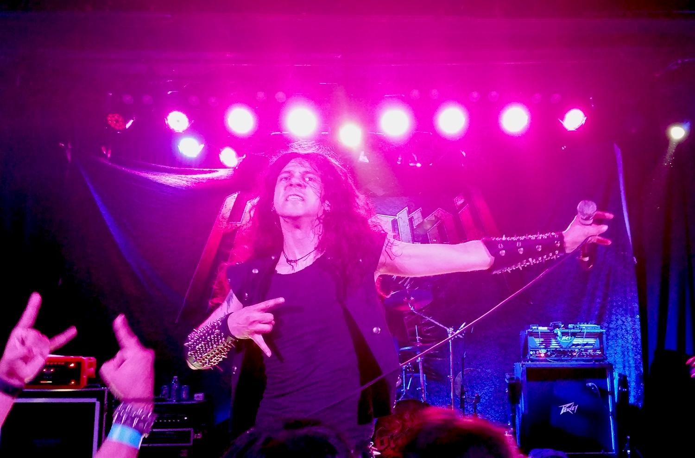 Holy Grail singer James Paul Luna keeping the metal horns raised high